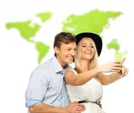 Couple against world map Royalty Free Stock Photos