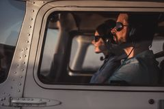 Couple in aircraft stock image