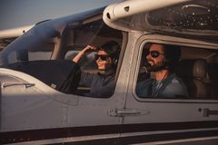 Couple in aircraft royalty free stock image
