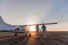 Couple and aircraft royalty free stock photos