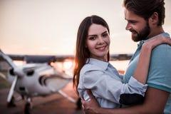 Couple and aircraft royalty free stock photos