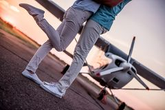 Couple and aircraft royalty free stock photo