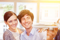 Couple with airplane model Stock Images