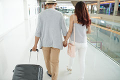 Couple in airport Stock Photos