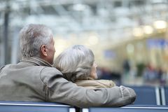 Couple at airport. Senior couple at airport sitting on bench Royalty Free Stock Photo