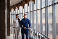 Couple at airport waiting aircraft. Passengers at a terminal. royalty free stock image