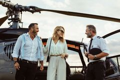 Couple alighted from a helicopter thanking pilot stock images