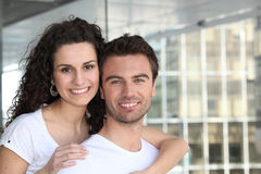 Couple all smiles near building stock images