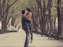 Couple at alley in city. Stock Images
