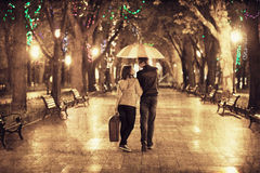 Couple at alley in night lights. Photo in vintage multicolor style Stock Photo