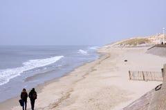 Couple along sand beach royalty free stock image