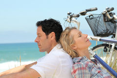 Couple alseep by the sea Stock Image