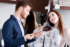 Couple is amazed with special prices. On the clothes Royalty Free Stock Photo