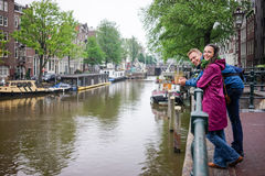 Couple in Amsterdam rainy day Stock Photography