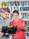 Couple Analyzing Toolkit In Store Royalty Free Stock Photos