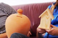 Couple And Moneybox Stock Image