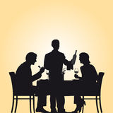 Couple And Waiter In Restaurant Stock Photo