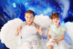 Couple of angels. Beautiful little angels at a snowy background Royalty Free Stock Photography
