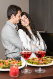 Couple anniversary with love. Romantic anniversary dinner. A young couple embracing with love during the celebration Stock Image