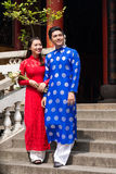 Couple in ao dai dresses Royalty Free Stock Image