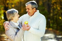 Couple with apple Stock Images