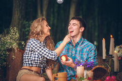 Couple with an apple and cherry Royalty Free Stock Image