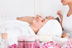 Couple Applying Facial Mask Royalty Free Stock Image