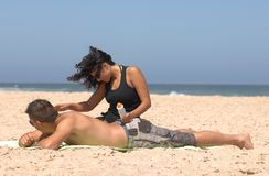 Couple applying suncream Royalty Free Stock Photo