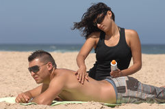 Couple applying suncream Stock Images