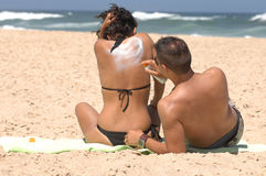 Couple applying suncream Royalty Free Stock Image