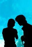 Couple in the aquarium. Silhouette stock photo