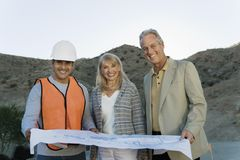 Couple With Architect At Construction Site Royalty Free Stock Image