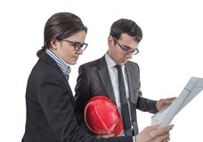 Couple of architects revising house project Royalty Free Stock Photos