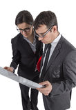Couple of architects revising a house project on white backgroun Stock Photo