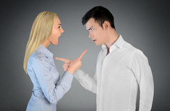 Couple argue. And pointing eachother Stock Photos