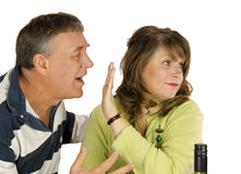 Couple Arguing. Unhappy middle aged couple arguing over lunch royalty free stock photography