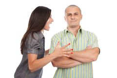 Couple arguing. Young couple having a domestic fight, isolated on white background Royalty Free Stock Photography