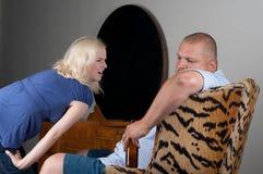 Couple arguing about alcohol addiction Stock Photos