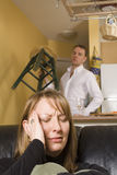 Couple arguing in apartment Royalty Free Stock Images