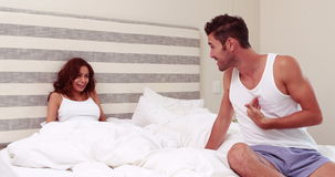 Couple arguing in bed. At home stock footage