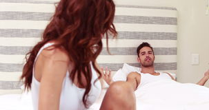 Couple arguing in bed stock video footage