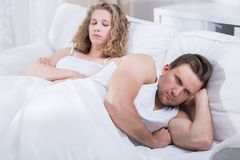 Couple arguing in bed Royalty Free Stock Image