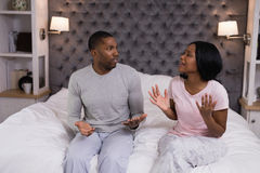 Couple arguing in bedroom at home stock images