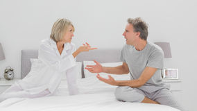 Couple arguing in bedroom Stock Photos