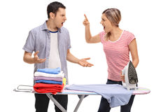 Couple arguing behind an ironing board Royalty Free Stock Photo