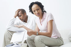 Couple Arguing About Bills. Worried African American couple arguing about bills Stock Images