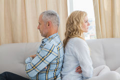 Couple arguing on the couch Stock Photos
