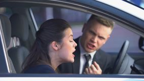 Couple arguing desperately in car lady leaving family conflict, misunderstanding stock footage