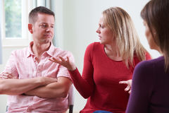 Couple Arguing In Front Of Relationship Counsellor. Couple Argue In Front Of Relationship Counsellor royalty free stock image