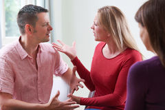 Couple Arguing In Front Of Relationship Counsellor. Couple Discuss Problems With Relationship Counsellor stock photo